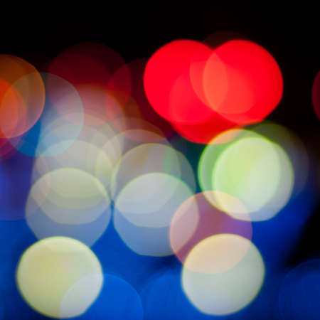 Blurred defocused lights background of city at night. Bokeh sparkling lights. Christmas blurred lights background. Abstract colorful background. Stock Photo - 17924910