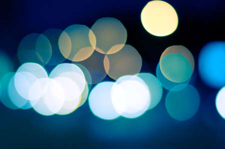 sparkling and defocused lights background. blue bokeh background. abstract blurred lights photo