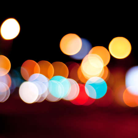 Blurred defocused lights background of city at night. Bokeh sparkling lights. Stock Photo - 18003963