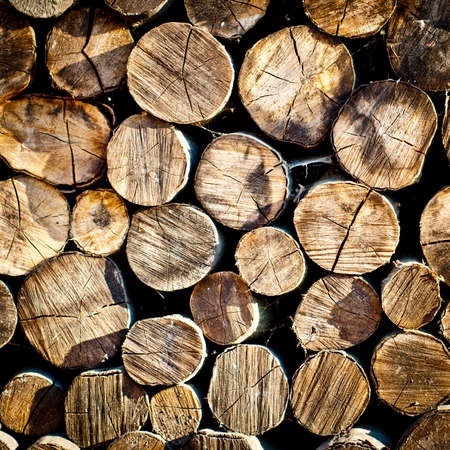 fire wood background texture. closeup of chopped fire wood stack photo