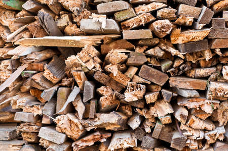 fire wood heat: fire wood background. recycled wood pile closeup. waste wood. Stock Photo