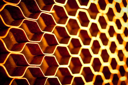 Abstract hexagonal structure with shallow dof. Metal honeycomb mesh. Technology concept. photo