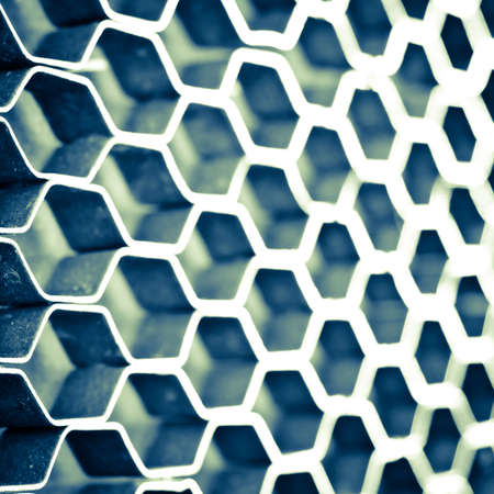 Abstract hexagonal structure with shallow dof. Blue metal honeycomb mesh. Technology concept. photo