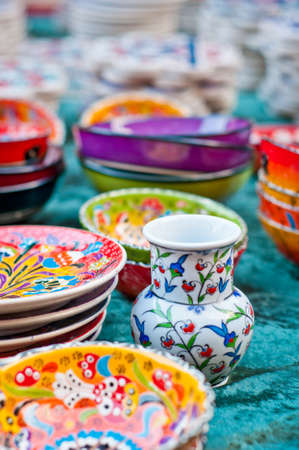 Colorful pottery bowls and dishes. Handmade folk art.