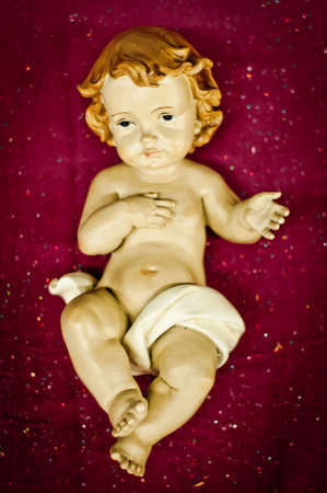 child jesus: New Born Baby Jesus Christ figure on purple background