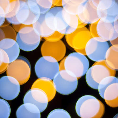 Blurred lights background. Christmas defocused lights background. Bokeh sparkling lights. Abstract colorful background. photo