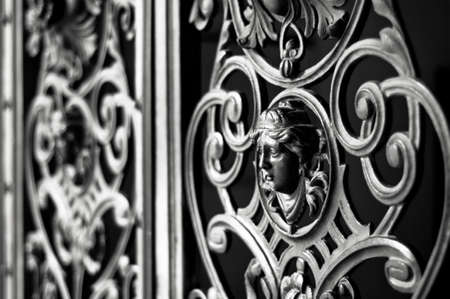 iron fence: Decorative metal gate ornament. Antique iron door with classic ornaments.