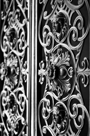 Decorative metal gate ornament. Antique iron door with classic ornaments. photo