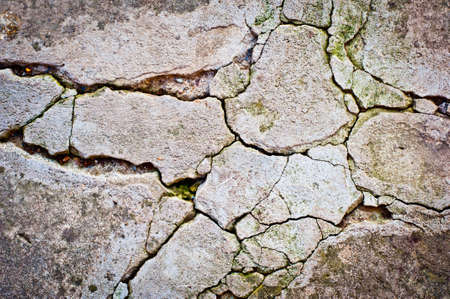 cracked cement: grunge texture background. Old cracked cement wall texture. Stock Photo