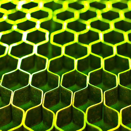 greem: Abstract hexagonal structure with shallow dof. Green metal honeycomb mesh. Technology concept. Stock Photo