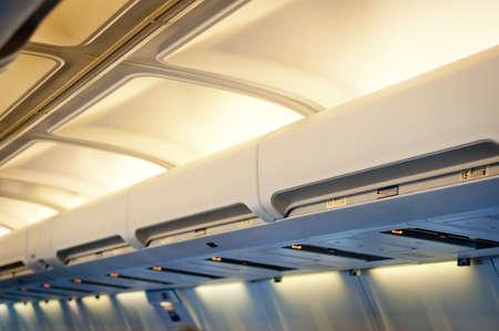 Airplane interior detail. Luggage shelf row.