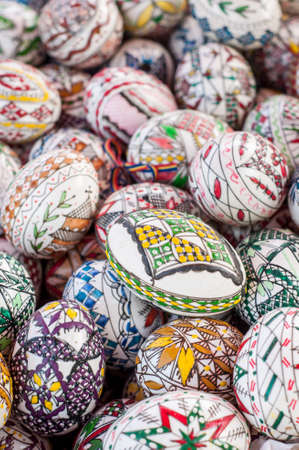 Decorated Easter eggs. Beautiful, colorful traditional Romanian handcrafted easter eggs. Folklore. Stock Photo