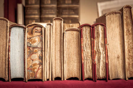 manuscripts: Books with leather covers in a row. Old manuscripts. Aged, used books.