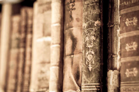 stacked books: Books with leather covers in a row. Old manuscripts. Aged, used books.