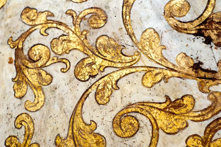 carvings: Fourish pattern. Gold leaf floral design on white background. Old, antique surface. Stock Photo