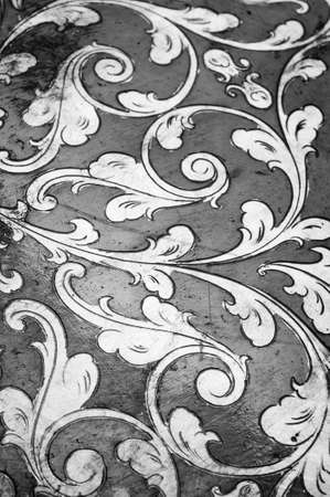 the renaissance: Fourish pattern. Gold leaf floral design. Black and white, grayscale. Old, antique surface.