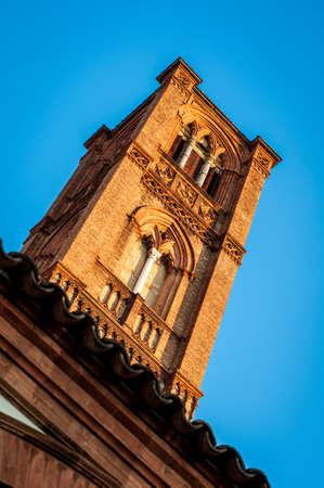 Church tower street view. San francesco abbey bell tower. Bologna, Italy. Stock Photo