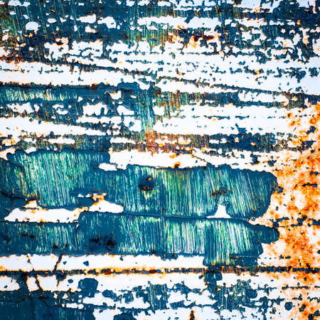 urban decay: Grunge texture background. rusty metal with cracked paint. distressed surface.
