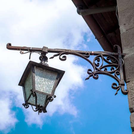Old street lamp.  Streetlight with metallic ornaments.