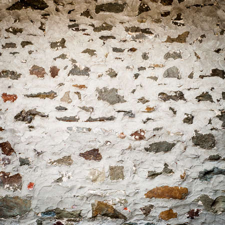 Old stone wall texture. Weathered and worn stone structure. Imagens - 96959975