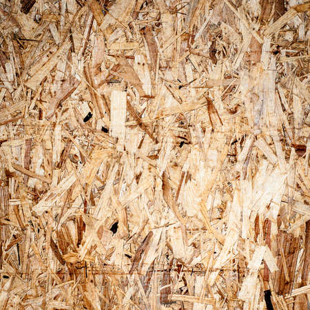 wooden board texture background. OSB.  Oriented Strand Board building material closeup.