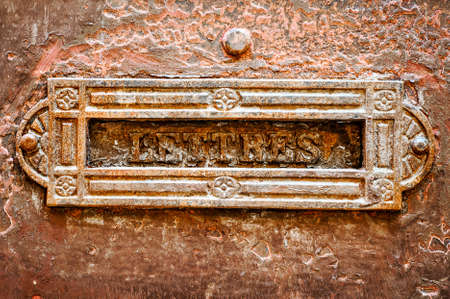 Old letter slot closeup background Stock Photo