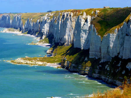 Chalk cliffs and stony coastline at atlantic ozean in Normandy, France.