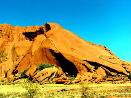 Uluru, Australia 19 10 2009: red Uluru, ayres rock walk around in Uluru-Kata Tjuta National Park in Northern Territory Stock Photo