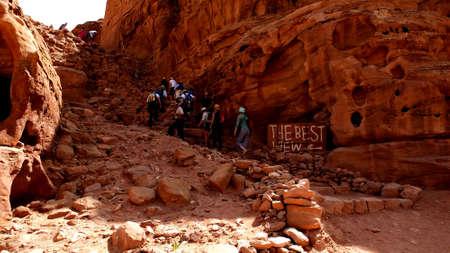 Petra, Jordan 19 04 2014: Tourists trekking up the mountain with best view sign in worldwonder in Petra in Jordan