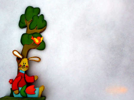 Easter bunny in the snow wooden with tree and copy space for text happy easter