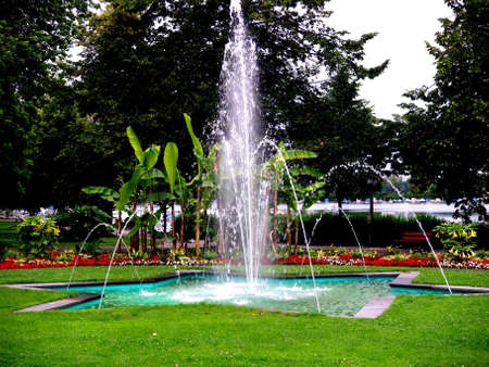 Park in Lindau at Bodensee with water fontaine in Germany in summer time Stock Photo