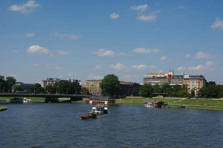 River in Krakow with blue water and blue cloudy sky