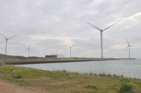 Wind turbines with cloudy sky and ocean