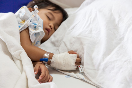 asian hospital: Close up of hand children sick sleeping on the bed at the hospital Stock Photo