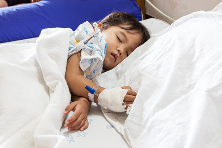 Children sick sleeping on the bed at the hospital 免版税图像