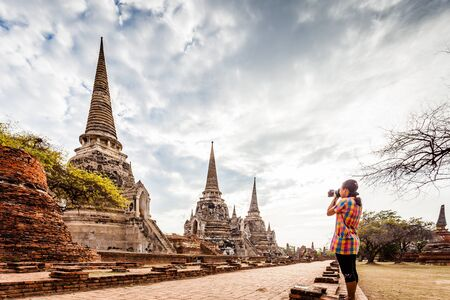 historic sites: Traveler take a picture of Ayutthaya Old Town filled with historic sites, Ayutthaya Historical Park, Thailand Stock Photo
