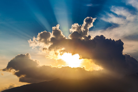 golden rays of the sun through the black clouds Stock Photo