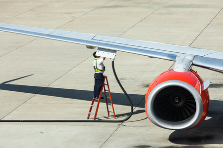 Airplane prepare for fight and loading the bags at the airport Stock Photo