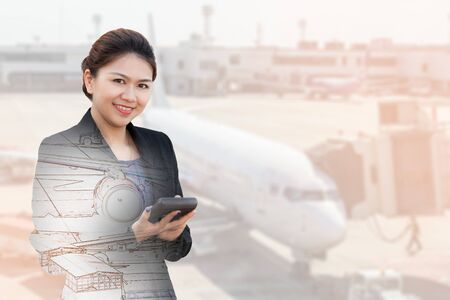 exposure: Double exposure of businesswoman using calculator with aeroplane in airport