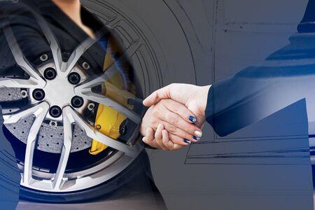 disk break: Double exposure of business handshake with wheel car