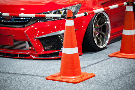 Tuned customized car in parking with cone partition