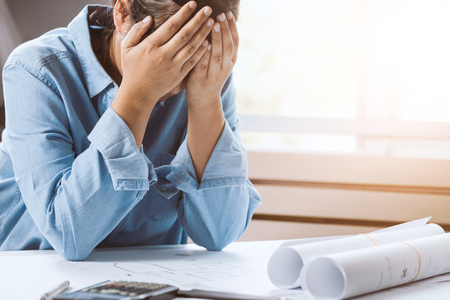 Close-up of architect female stressed and under pressure in the office Stock Photo
