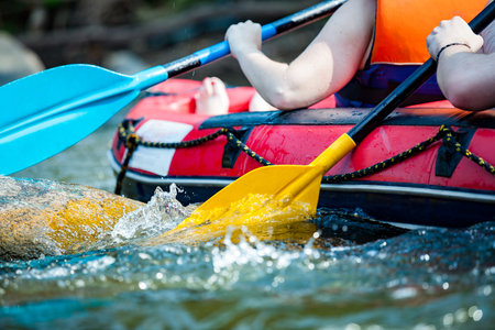 Close-up hand of young person is rafting on the river, extreme and fun sport at tourist attraction Stock Photo