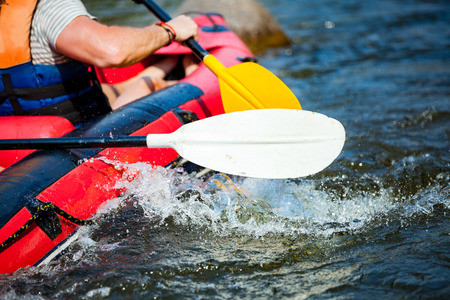 Focus some part of young person are rafting in river.