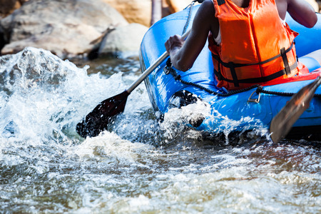Close-up of young person rafting on the river, extreme and fun sport at tourist attraction Foto de archivo
