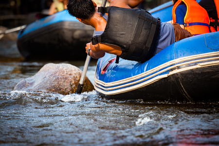 Close-up of young person rafting on the river, extreme and fun sport at tourist attraction Stock Photo