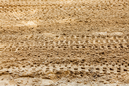 Wheel tracks print on countryside dirt route, background image Stok Fotoğraf