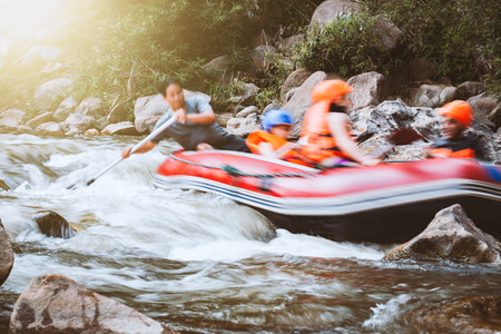 Motion blur of young person rafting on the river, extreme and fun sport at tourist attraction