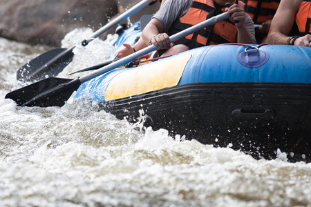 Young person rafting on the river, extreme and fun sport at tourist attraction