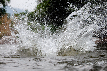 Close-up of water huge splashing in pond from people falling into water, abstract art picture for background Stock Photo